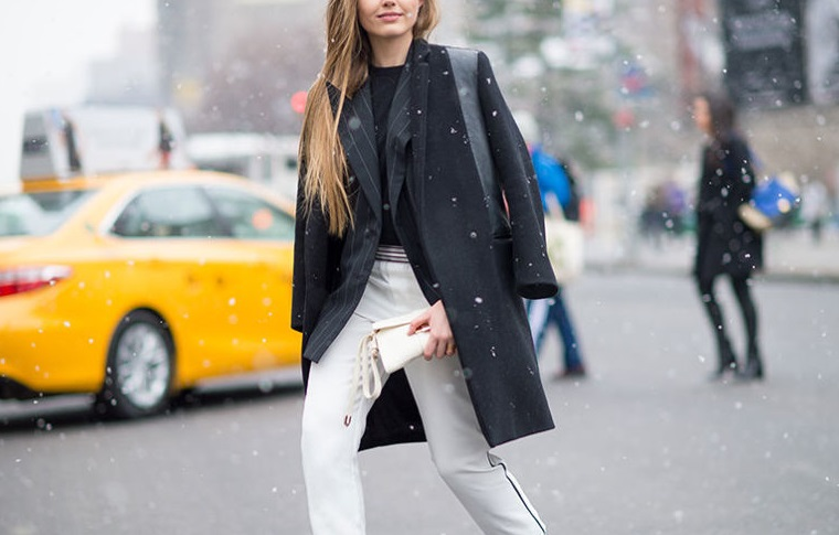 nyfw winter layers freezing elle pinstripes pinstripe blazer white pants winter whites tuxedo pants jacket on shoulder black coat black ankle boots